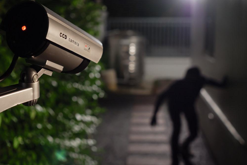 Home security camera capturing intruder